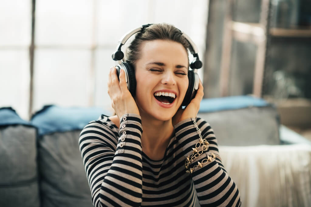 Woman smiling and listening to music