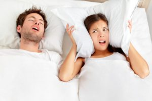 Man Snoring / Woman Covering Ears